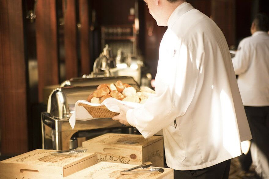 Server carrying bread