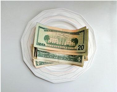 money on dining plate