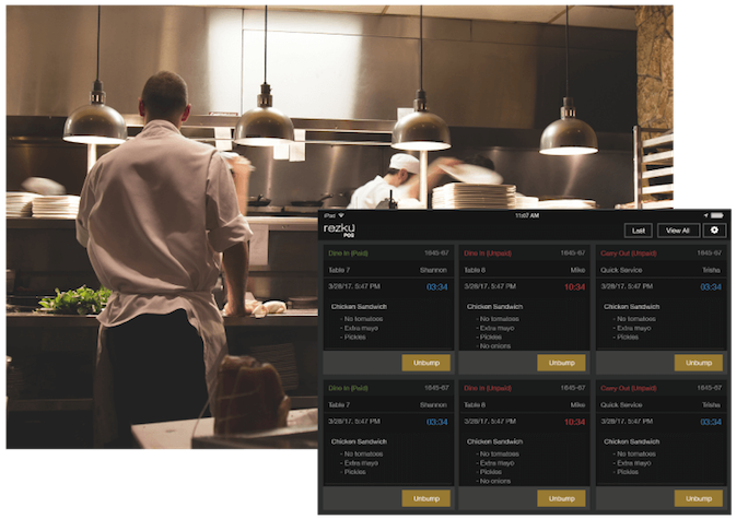 iPad kitchen display system being used in busy kitchen